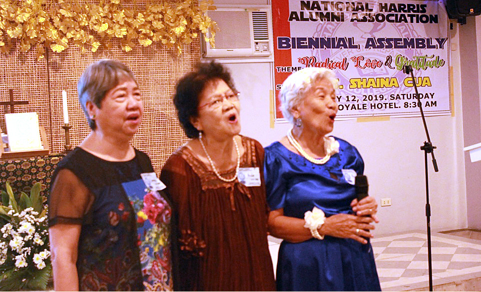 Zenaida P. Lumba (left), a 1959 graduate and former president of Harris Memorial College in Taytay, Philippines, stands with deaconesses Aluida Kasiguran (center) and Pag-asa Tecson-Lucas during the Harris alumni assembly. Photo by Gladys Mangiduyos, UMNS.