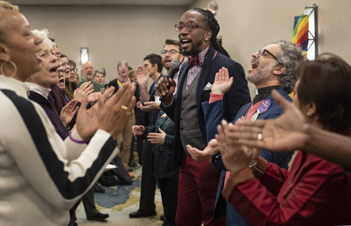 """The singing of """"This Little Light of Mine"""" opens a Feb. 22 gathering on the eve of the 2019 General Conference that featured openly gay delegates and others supporting full inclusion of LGBTQ people in The United Methodist Church. The Rev. Jay Williams (center) led the singing and also moderated a panel discussion. Photo by Kathleen Barry, UMNS."""