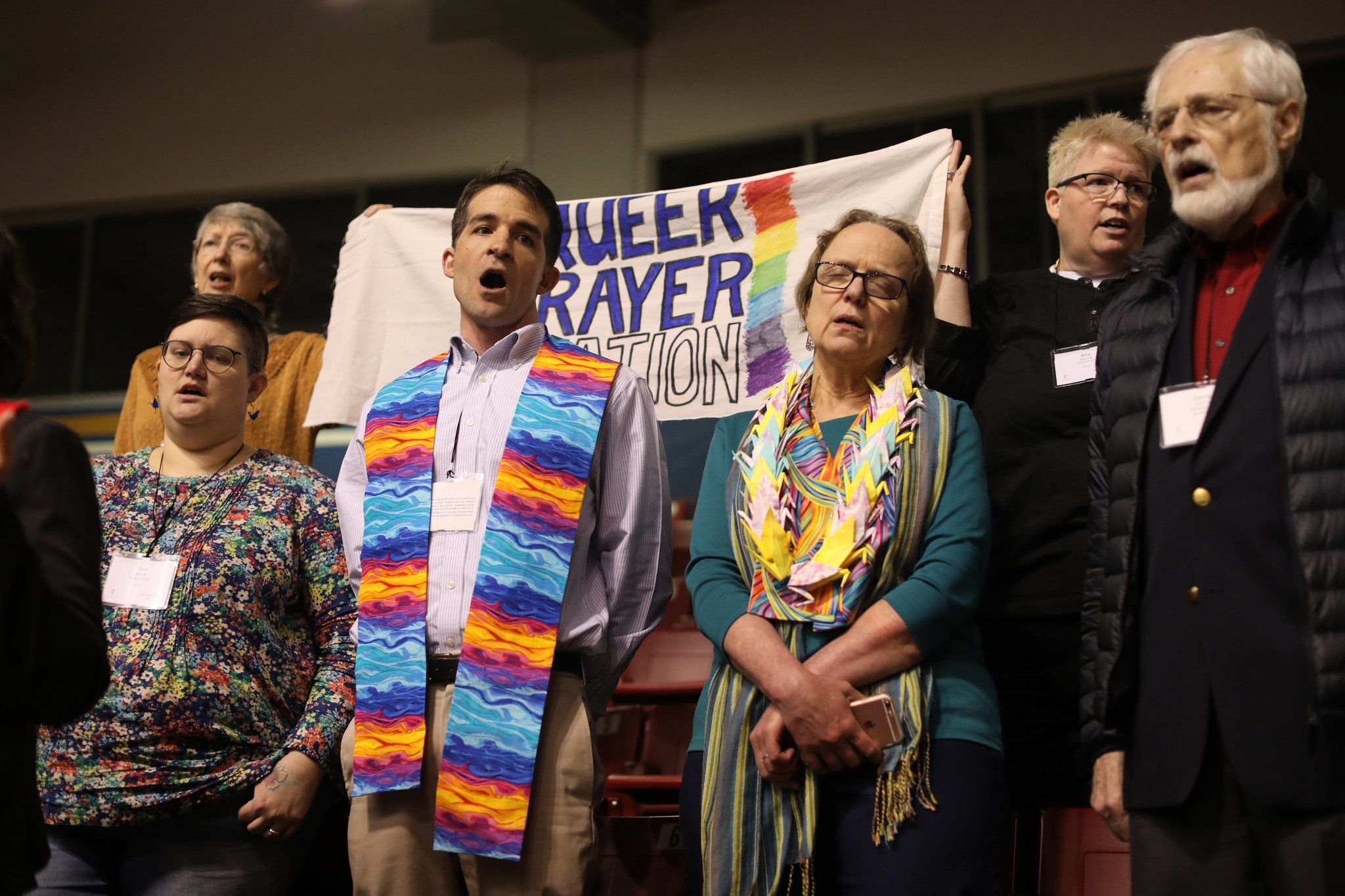 "The Rev. Will Green (center) leads the singing of ""Jesus Remember Me When You Come Into Your Kingdom"" at the ""Queer Prayer Station"" during the Feb. 23 morning of prayer at the 2019 Special Session of the United Methodist General Conference in St. Louis. Photo by Kathleen Barry, UMNS."