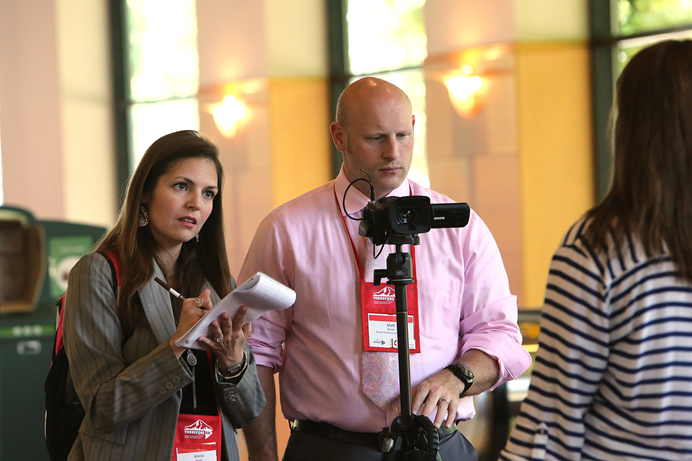 South Carolina communicators, Jessica and Matt Brodie, interview Elizabeth Murray, a page and marshall during the 2016 United Methodist General Conference in Portland, Ore. Photo by Kathleen Barry, UMNS..