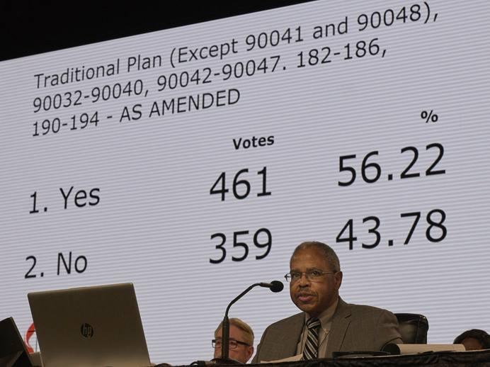 As the Rev. Joe Harris presides over the legislative committee, the results of a vote approving the Traditional Plan as amended by 461-359 are displayed. The vote must still be approved by the plenary session on Feb. 26, the final day of the special session of the 2019 General Conference of The United Methodist Church in St. Louis. Photo by Paul Jeffrey, UMNS.