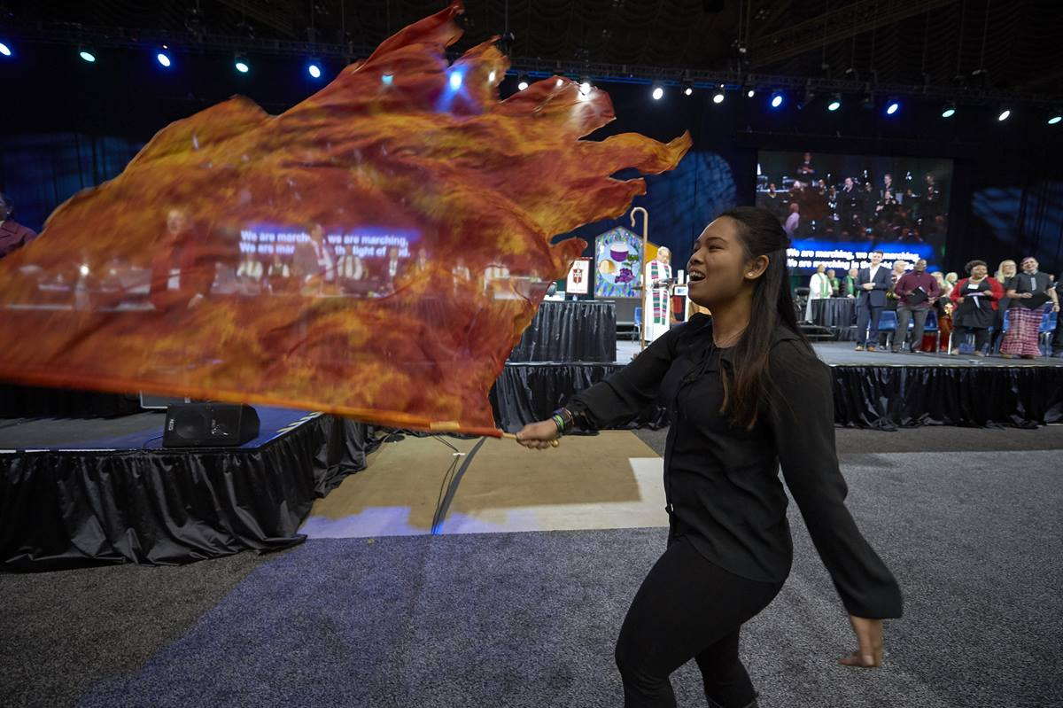 A liturgical dancer waves a flag during worship on February 24, 2019, at the Special Session of the General Conference of The United Methodist Church, held in St. Louis, Missouri. Photo by Paul Jeffrey, UMNS.
