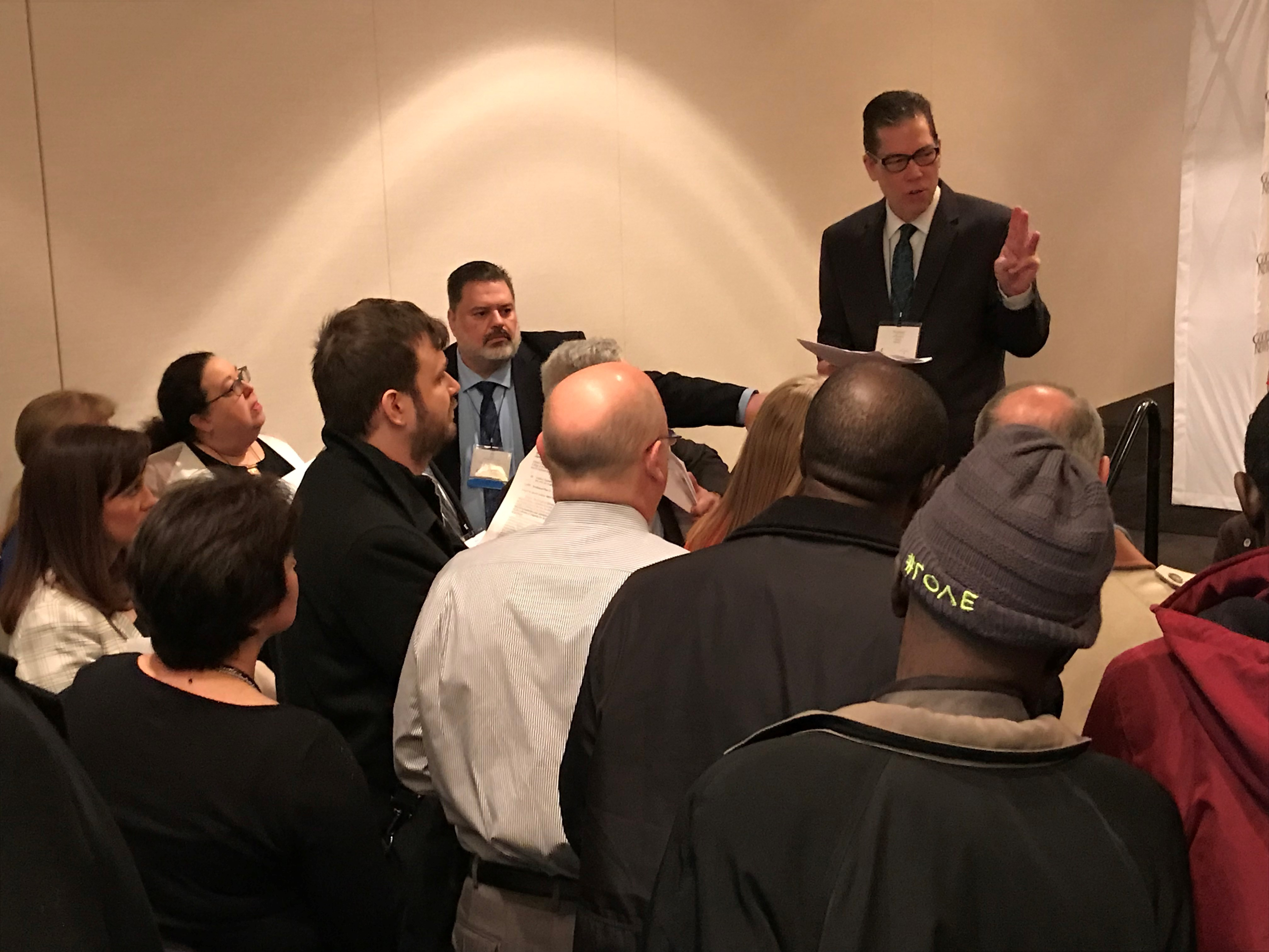 The Rev. Tom Lambrecht gives directions to General Conference 2019 delegates at the Feb. 25 breakfast briefing sponsored by Good News, the unofficial traditionalist advocacy group within The United Methodist Church. Photo by Sam Hodges, UMNS.