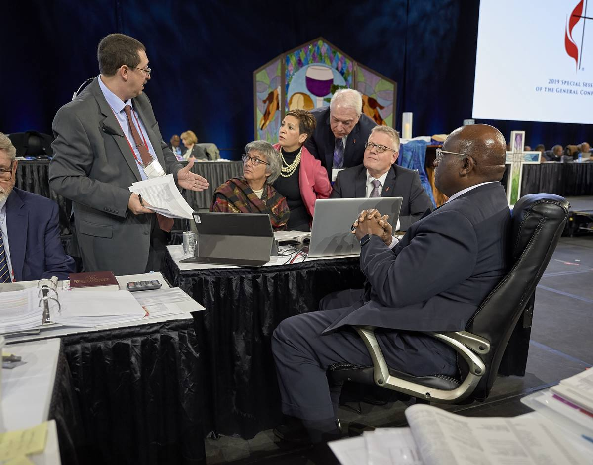 Following the announcement of a Judicial Council ruling that found several parts of the Traditional Plan unconstitutional, church officials confer during a pause in the Feb. 26 plenary session of the 2019 General Conference in St. Louis. Photo by Paul Jeffrey, UMNS.