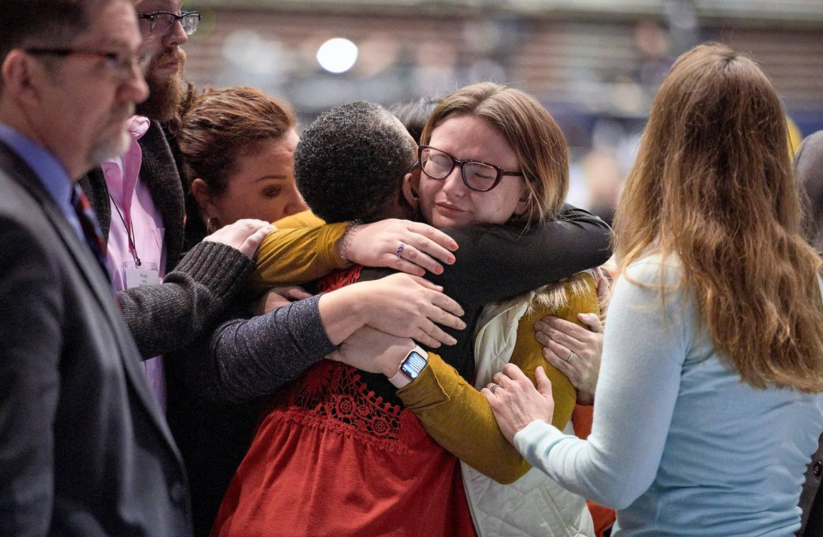 Delegate Shayla Jordan receives hugs after speaking in support of the One Church Plan during the 2019 United Methodist General Conference in St. Louis. Young United Methodists have differing views on whether the Traditional Plan, adopted by the special General Conference, is the best way forward for the denomination. Photo by Paul Jeffrey, UMNS.