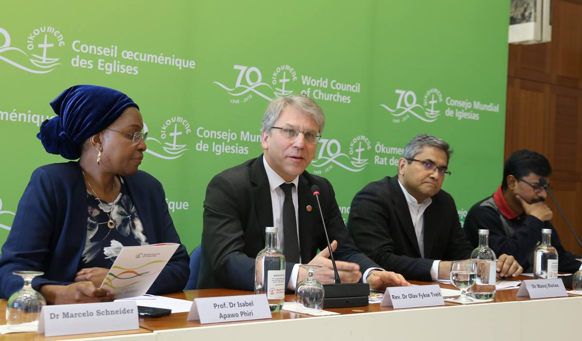 Staff at the World Council of Churches speak during a public launch in Geneva for a new downloadable resource to help churches take practical steps to care for the earth. The event also honored the legacy of the Rev. Norman Tendis, who died in the Ethiopian Airlines crash two days earlier. From left are Isabel Apawo Phiri, the Rev. Olav Fykse Tveit,  Dr. Manoj Kurian and Dinesh Suna. Photo by Ivars Kupcis/WCC.