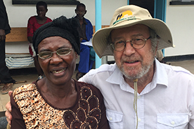 Don Ziegler, head of The Nyadire Connection's eyeglasses program, poses with 72-year-old Mabel Chibuounda in Chindenga, Zimbabwe. Chibuounda could only read two lines of the eye chart before receiving new glasses. Photo courtesy of Don Ziegler.