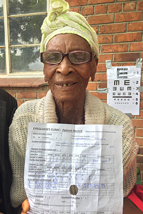 Gladis Chikoto, who is 110 years old, shows off her new glasses and test results after attending an eyeglasses clinic in rural Zimbabwe. Photo courtesy of Don Ziegler.