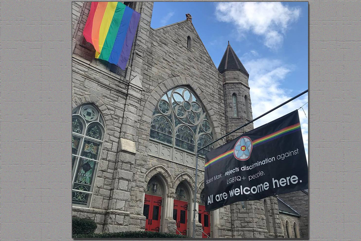 A banner with a message of inclusion and a rainbow flag fly outside Saint Mark United Methodist Church in Atlanta. Resistance continues to passage of the Traditional Plan at last month's special called General Conference in St. Louis. Photo courtesy of Saint Mark United Methodist Church.