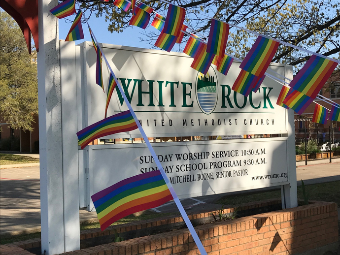 Rainbow flags fly from the sign at White Rock United Methodist Church in Dallas, just one indication of resistance to passage of the Traditional Plan at last month's General Conference. The church's pastor, the Rev. Mitchell Boone, has announced he's willing to go against church law by performing same-sex weddings. Photo by Sam Hodges, UMNS.