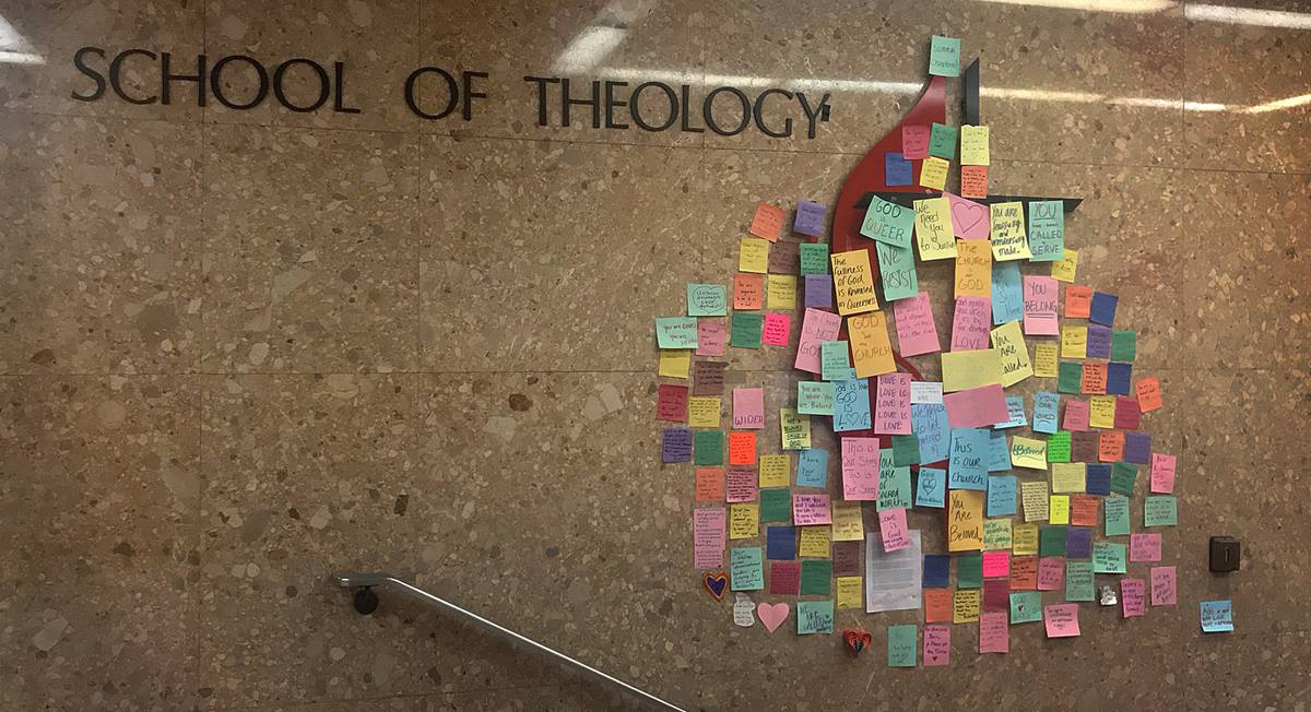 Messages of support for LGBTQ students cover the United Methodist cross and flame in a hallway at the Boston School of Theology after the special General Conference voted to affirm and strengthen the denomination's rules against gay clergy and same-sex weddings. Photo by Anastasia Kidd, Boston School of Theology.