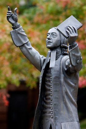 """A statue of John Wesley, the founder of Methodism, stands in the center of campus at Asbury Theological Seminary in Wilmore, Ky. Asbury officials issued a statement that said they were """"thankful"""" for the passing of the Traditional Plan. File photo by Mike DuBose, UMNS."""