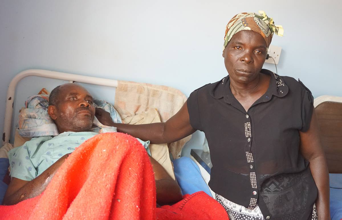 Cyclone Idai survivor Geshem Makufa, 55, is being treated at United Methodist Mutambara Mission Hospital in the Chimanimani District of Eastern Zimbabwe. He is pictured with his wife, Tandiwe Makufa. Photo by Kudzai Chingwe, UMNS.