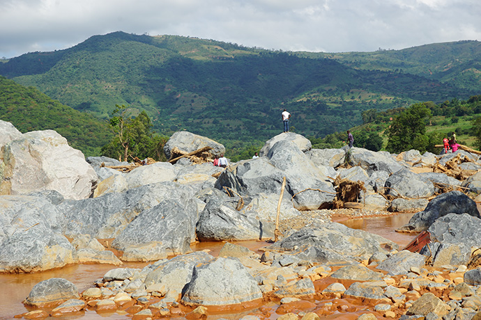 Boulders now sit where houses and a police camp used to be before Cyclone Idai hit Kopa Township, Zimbabwe. Photo by Kudzai Chingwe, UMNS.