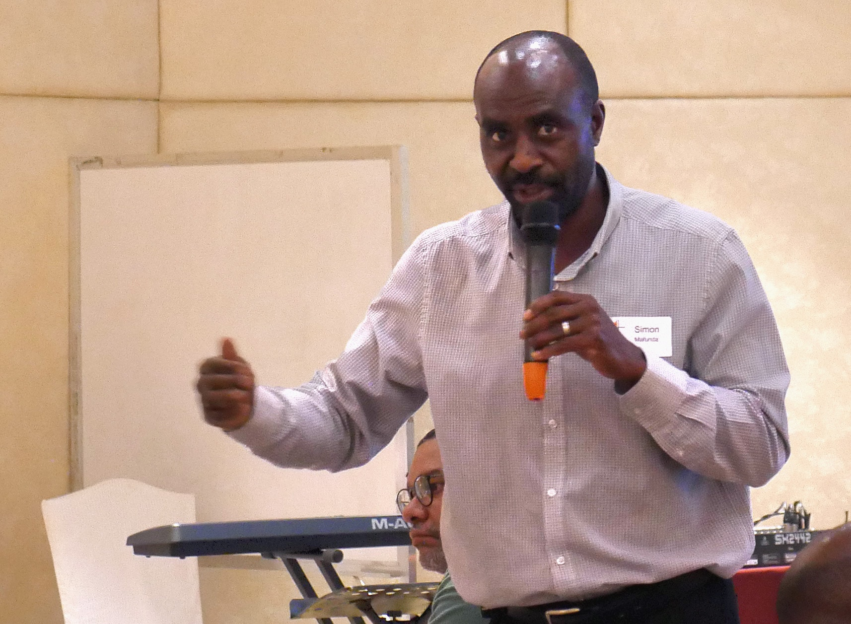 """Simon Mafunda of Harare, Zimbabwe, addresses fellow Standing Committee on Central Conference Matters. After the special General Conference, he said he has heard from Africans who feel like """"they are being treated like perpetrators."""" Photo by Heather Hahn, UMNS."""