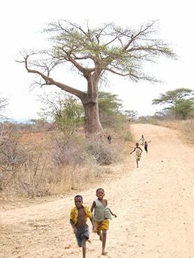 Children run down a road toward Hanwa Mission School in Hanwa, Zimbabwe. The school is now officially a United Methodist school. File photo by Chenayi Kumuterera, UMNS.