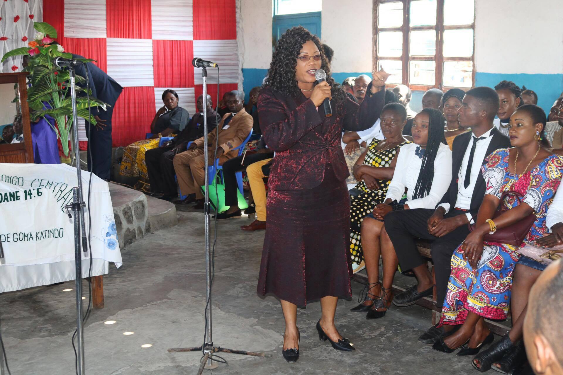 Therese Ndjovu speaks to members of the Amani Local Church at Goma in Kivu about efforts to help widows and children. Photo by Philippe Kituka Lolonga, UMNS.