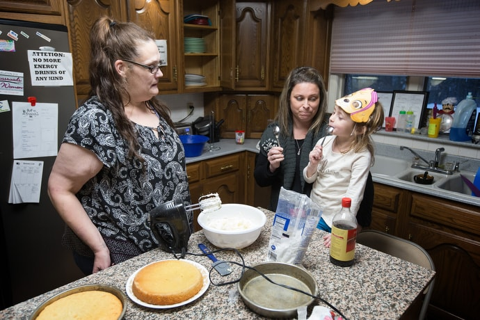 Cindy (left), a resident of Staggers Recovery House in Keyser, W.Va., bakes a cake with help from Kennedy (5) and her mother, Kateri Fazenbaker, the center's director. Staggers House is part of Burlington United Methodist Family Services, a charitable network related to Burlington United Methodist Church. Photo by Mike DuBose, UMNS.