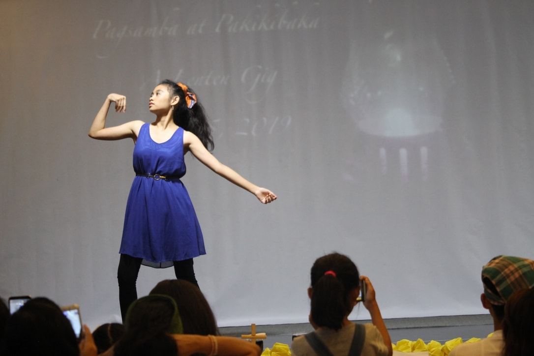 Clellandley Bueno, a student from Wesleyan University-Philippines, performs a dance during a Lenten event in Cabanatuan City, Philippines. The gathering was hosted by John Wesley Academy and Critical Thinking Center to decry the killings of 14 farmers in the Negros Oriental province. Photo by Gladys Mangiduoys, UMNS.