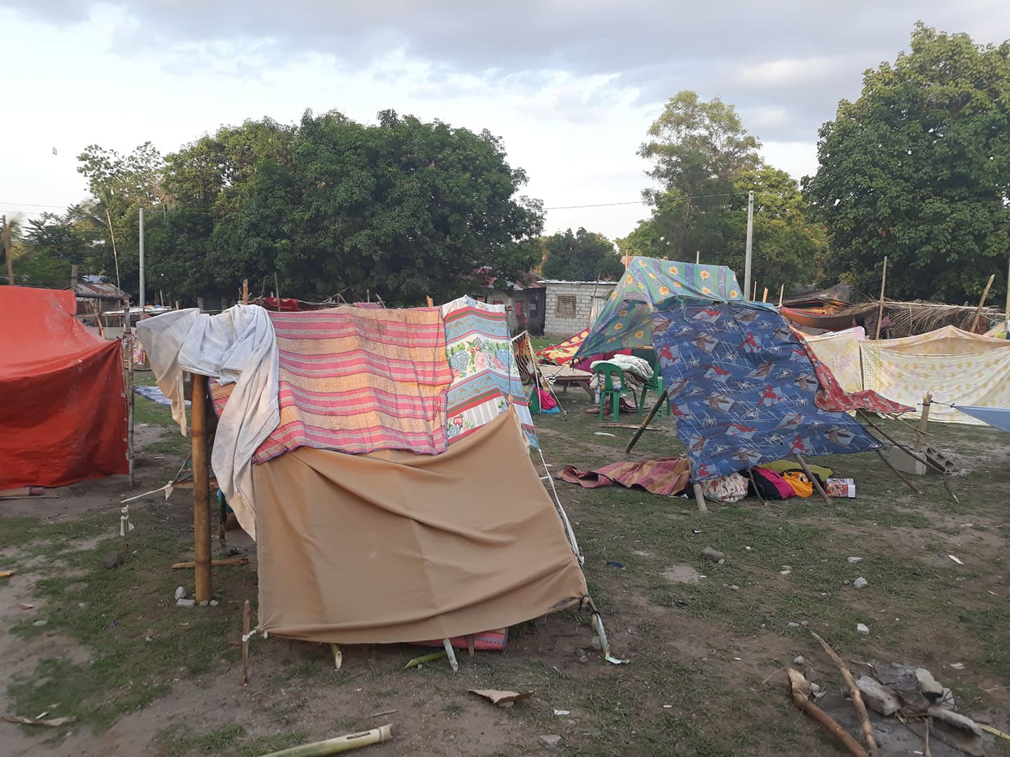 Earthquake evacuees take refuge in tents in Porac, Philippines, in the Pampanga province northwest of Manila. The indigenous Aetas built the tent city after the eruption of Mt. Pinatubo in 1991. Photo by Rommuel S. Flores.