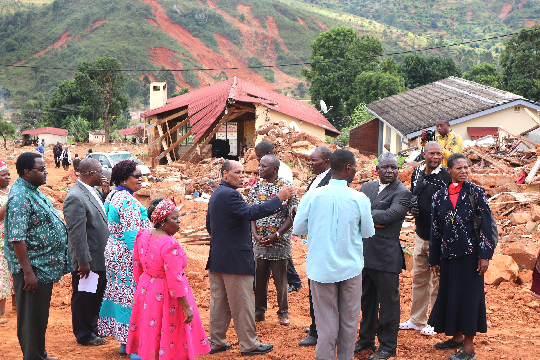 Bishop Eben K. Nhiwatiwa and other United Methodist church leaders tour Ngangu, Zimbabwe, an area hard hit by Cyclone Idai in March. Photo by Priscilla Muzerengwa, UMNS.