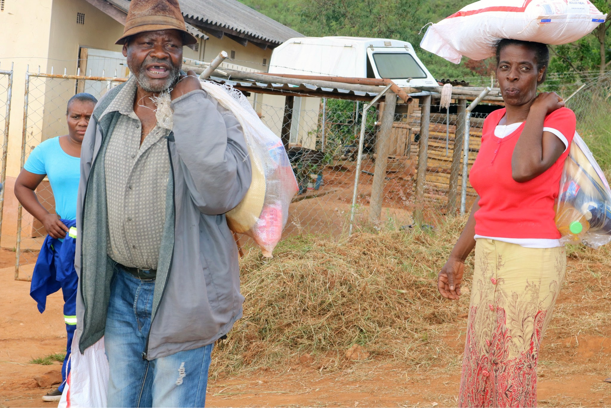 Cyclone Idai survivor Phillip Mushiri, 78, carries food and other supplies handed out by The United Methodist Church in Ngangu, Zimbabwe. Photo by Priscilla Muzerengwa, UMNS.