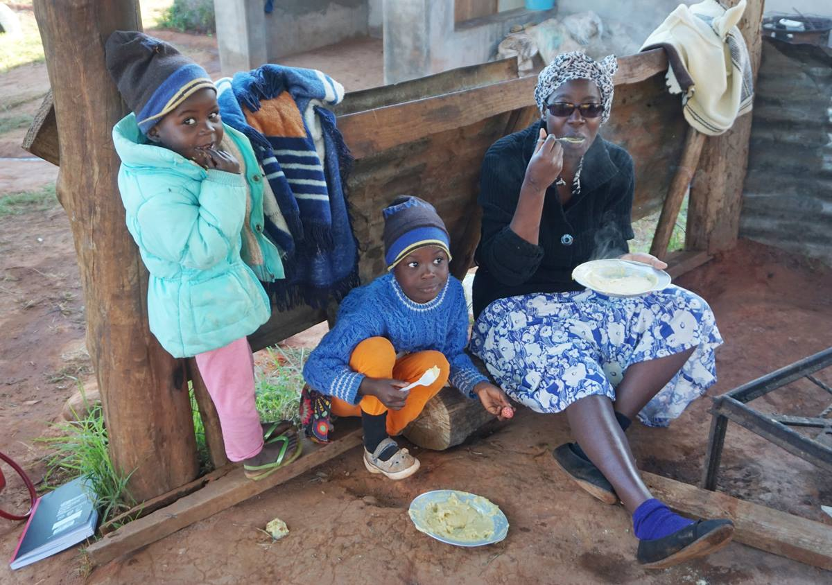 Irene Chingwaru eats with two of her surviving children at Ngangu United Methodist Church in Ngangu, Zimbabwe, after Cyclone Idai ravaged the region in March. She and her husband lost two sons, ages 9 and 14, in the cyclone. Photo by Kudzai Chingwe, UMNS.