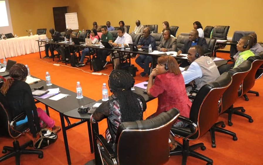 Attendees of the United Methodist Radio Network annual meeting listen on headsets during part of the conference, April 25-27, in Kampala, Uganda. Photo by the Rev. Taurai Emmanuel Maforo.