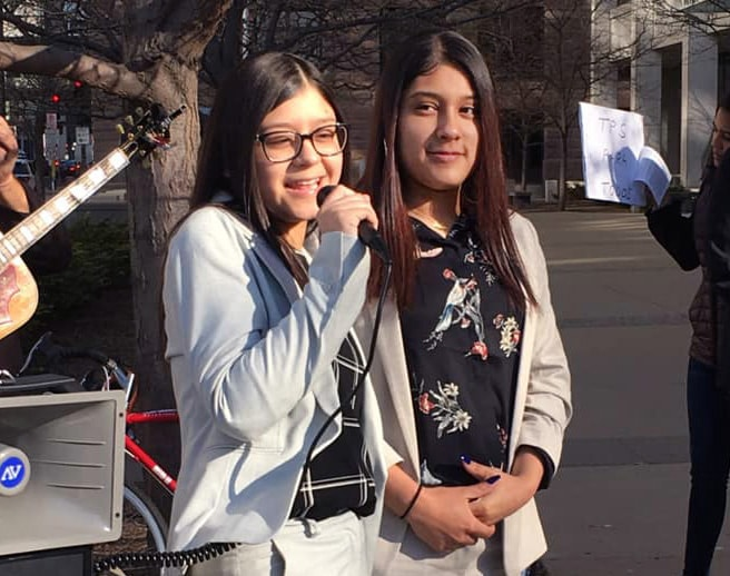 Nelson Pinos' daughters, Kelly and Arlly, speak at a prayer vigil across from the courthouse in St. Paul, Minn. Photo by Mary Elizabeth Smith.