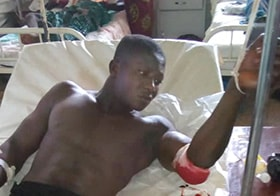 John Kamara rests at Connaught Hospital in Freetown after he and other members of his family were attacked at their home. Photo by Sayo Koroma.