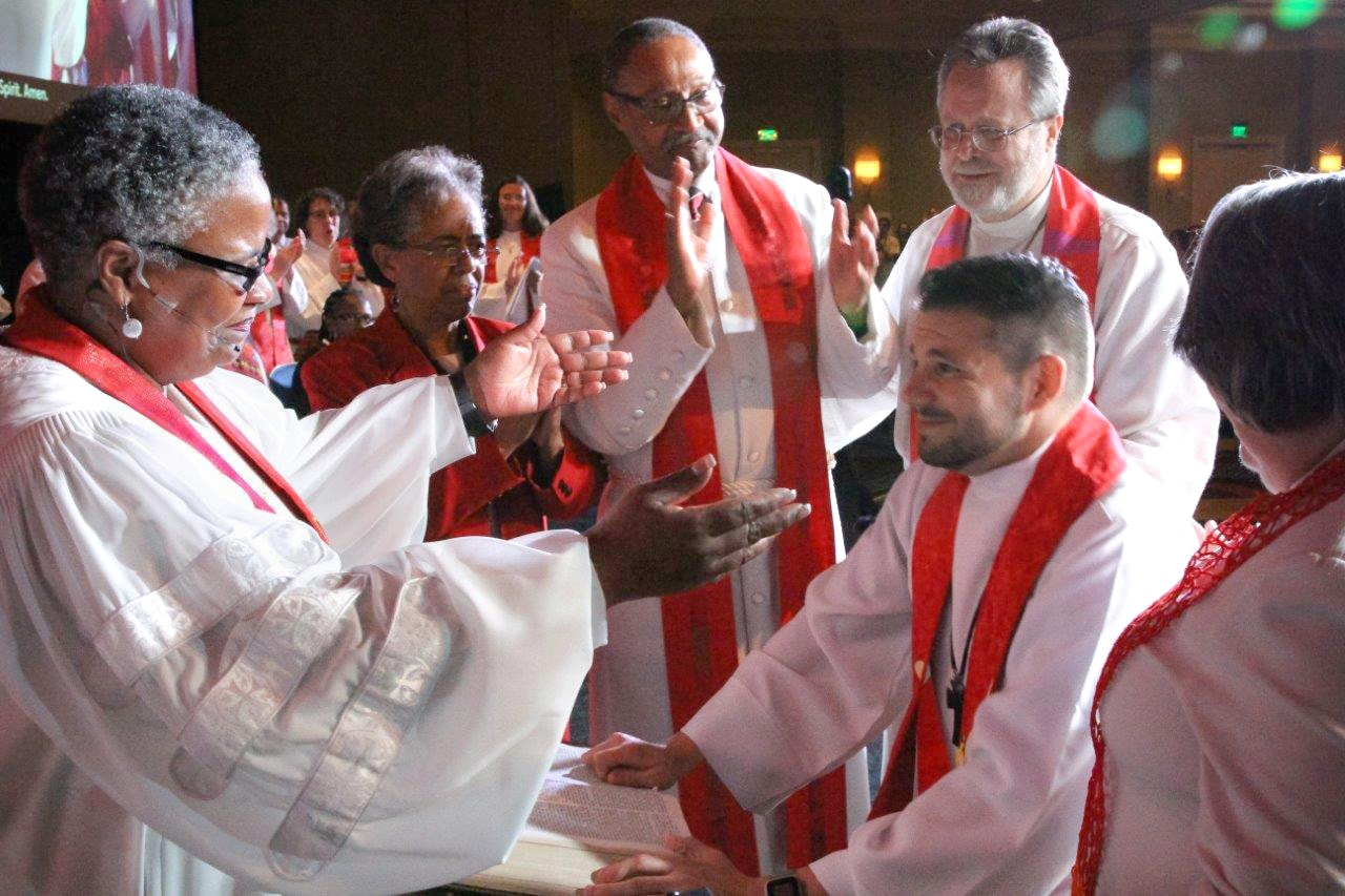 Bishop LaTrelle Easterling ordains the Rev. Joey Heath-Mason as a full elder at the May 31 ordination and commissioning service at the Baltimore-Washington Conference in Baltimore, Md. Heath-Mason is married to a person of the same gender. Photo by Alison Burdett, Baltimore-Washington Conference.