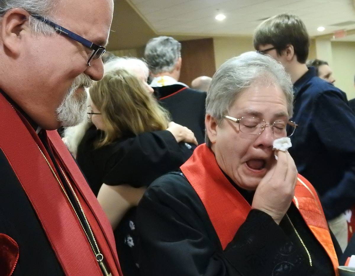 "The Rev. Jane Graner wipes away tears after her June 3 ordination as an elder in the North Texas Conference. Graner, 57, is openly gay. Church law prohibits ordination of ""self-avowed practicing"" homosexuals, but conference officials noted her single status and said she qualified for ordination. Photo by Sam Hodges, UM News."