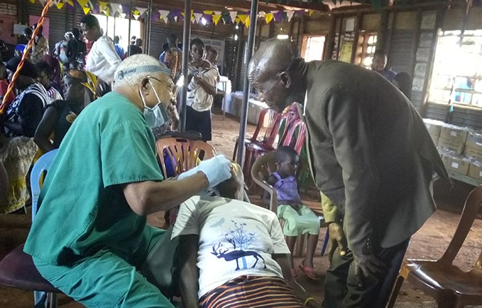 Dr. Julius Stephens, a retired dentist from South Carolina, volunteers with the health mission held in eastern Uganda. Photo by Vivian Agaba, UM News.