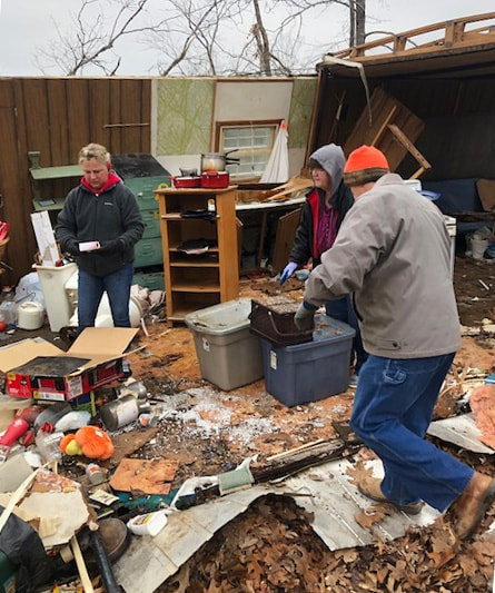 United Methodists in Arkansas salvage personal items from a destroyed home after spring tornados. Photo courtesy of Janice Mann, Arkansas Disaster Response Coordinator.