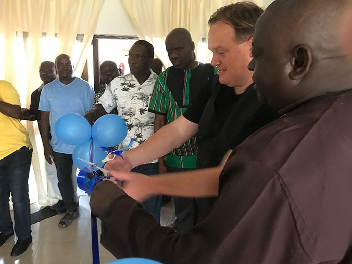 Dan Krause, top staff executive of United Methodist Communications in Nashville, Tenn., and Bishop John Wesley Yohanna, head of the Nigeria Episcopal Area, cut the ribbon during the dedication of the new communications center in Jalingo, Nigeria, on May 30, 2019. Photo by Tim Tanton, UM News.