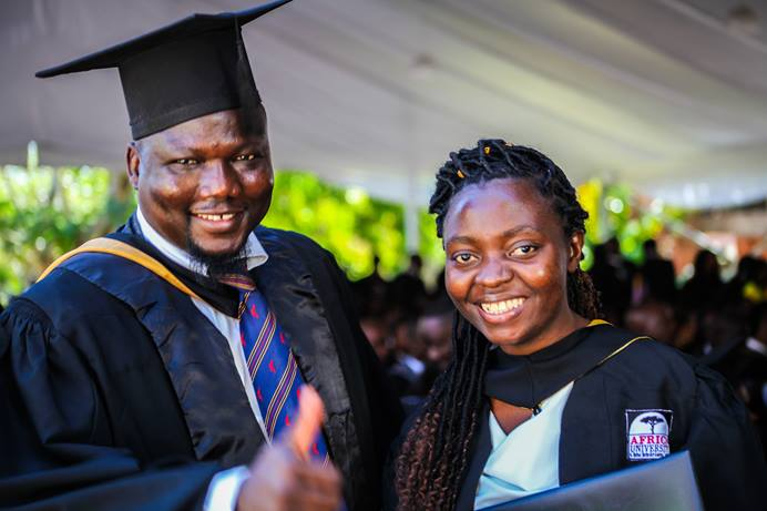 Claudine Migisha (right) receives congratulations from Wehnam Dabale, upon her graduation from Africa University in Mutare, Zimbabwe. Migisha, from Goma, Congo, was part of the United Methodist-related school's 25th graduating class. Dabale is the university's international student advisor. Photo courtesy of Africa University.