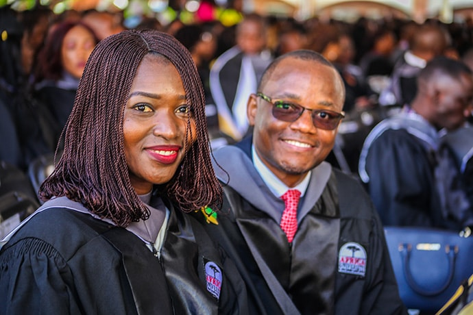 Pambi Jatutu Yusuf (left) and Chris Namilonga are among the 526 young women and men, representing 22 African countries who graduated from Africa University in 2019. Most are first-generation college graduates, and 54.6 percent are women. Photo courtesy of Africa University.