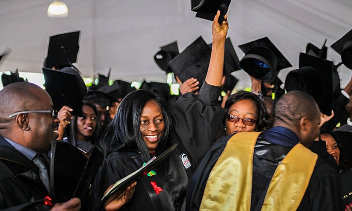"""Students and faculty celebrate graduation at Africa University. The school's vice chancellor,  Munashe Furusa, encouraged the graduates to """"go forth and build an Africa that we all want and deserve to live in."""" Photo courtesy of Africa University."""