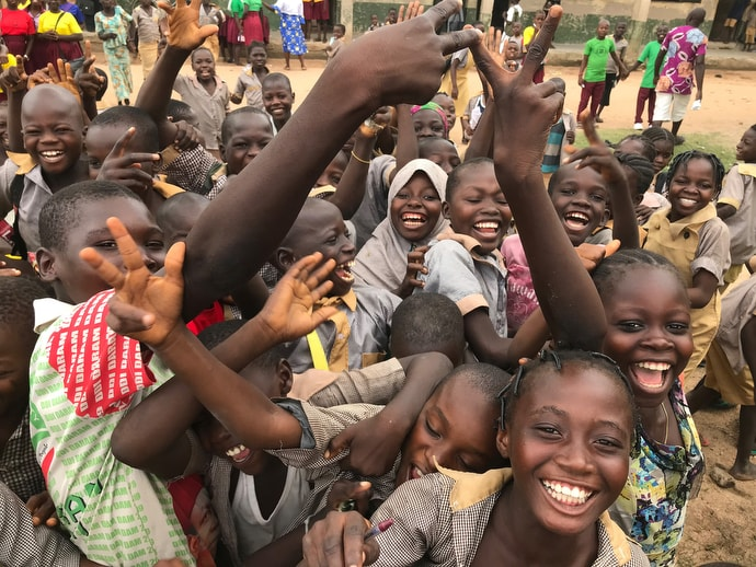Children at a center for internally displaced persons in Jalingo, Nigeria, greet a group of United Methodist visitors from the United States. Photo by Tim Tanton, UM News.