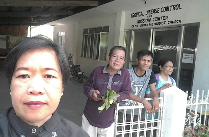 From left, the Rev. Glofie Baluntong, a United Methodist district superintendent, and the Revs. Wilfredo Yasay, Resty Herrera and Corazon Florece stand in front of the mission center at Dangay 3000 United Methodist Church in Roxas, Philippines. Photo courtesy of the Rev. Glofie Baluntong.