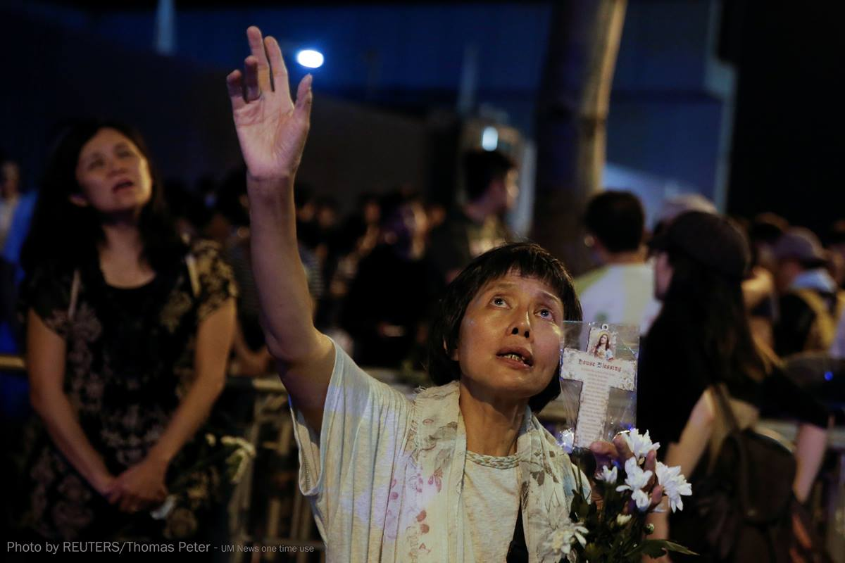 """The faithful sing religious songs outside the Legislative Council building in Hong Kong as they protest a proposed extradition bill with China. One hymn in particular, """"Sing Hallelujah to the Lord,"""" has become an unofficial anthem, says Ben Ho, a Methodist from Hong Kong. REUTERS/Thomas Peter"""