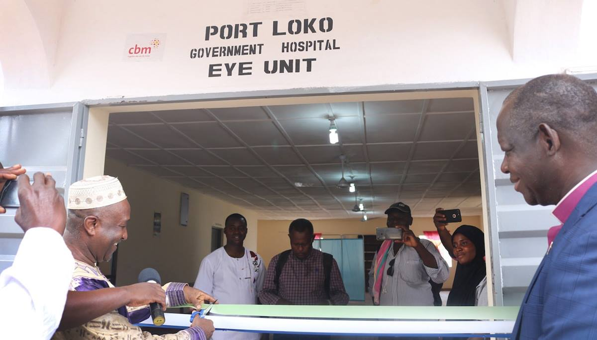 Bishop John K. Yambasu watches the ribbon cutting at the new eye clinic at the Port Loko Government Hospital in northern Sierra Leone. Photo by Phileas Jusu, UM News.