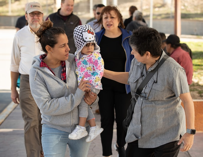 United Methodist deaconess Cindy Johnson (right) walks to buy medicine with Isabél, who traveled with her daughter from Nicaragua to Matamoros, Mexico, hoping to request asylum in the U.S. in January 2019. Kassandra, 16 months, was suffering from fever and weight loss while she and her mother waited for their turn to approach the bridge leading to Brownsville, Texas. Johnson makes regular visits to the border seeking to help migrant families. File photo by Mike DuBose, UM News.