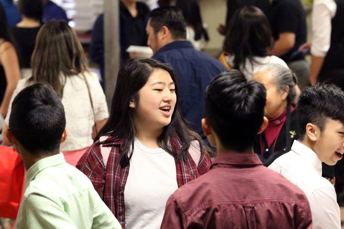 Young people fill the fellowship hall of ChristWay United Methodist Church in Milwaukee. At one time the church was concerned with insufficient financial resources. Now they don't have enough Sunday school rooms and parking spaces for their growing congregation. Photo by Thomas Kim, UM News.