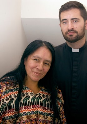 Maria Chavalan Sut stands with the Rev. Isaac Collins, pastor of Wesley Memorial United Methodist Church in Charlottesville, Va., during a news conference in October 2018. Chavalan Sut is living in the church to avoid deportation. Photo © Richard Lord.