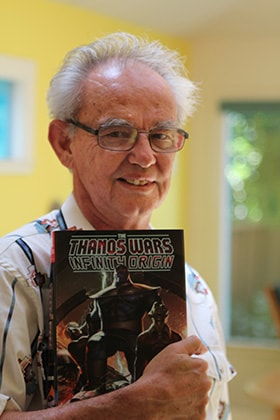 United Methodist deacon Mike Friedrich displays a comic book featuring the Marvel Comics villain Thanos. Friedrich wrote the first stories for the character, created by his roommate Jim Starlin. Photo by Spud Hilton.