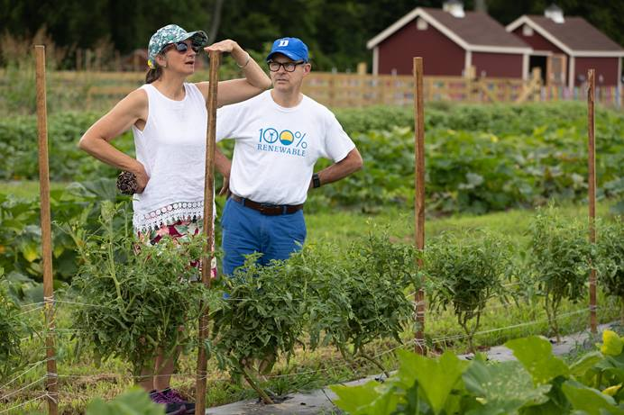 Phyllis Terwilliger takes note of the height of tomato stakes at The Giving Garden, a ministry of Franklin (Tenn.) First United Methodist Church that donates the food grown there to people in need. She and her husband, the Rev. Mark Terwilliger, from Countryside Community Church, a United Methodist fellowship in Clarks Summit, Pa., were attending the 2019 United Methodist Creation Care Summit in Nashville, Tenn. Photo by Mike DuBose, UM News.