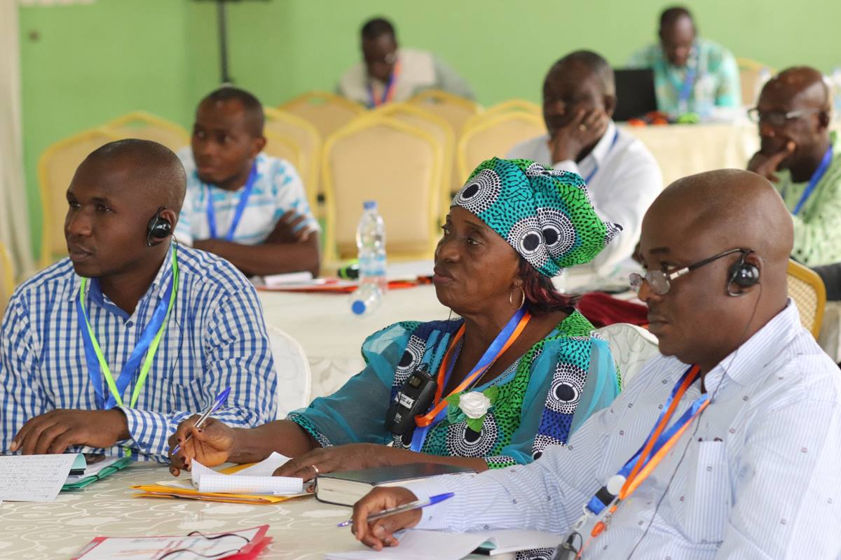 International participants listen during a presentation at the United Methodist HIV/AIDS summit in Abidjan, Côte d'Ivoire. From left are Augustin Bahati, communicator and member of the Rwanda Provisional Conference's health board;  Pauline Roberts, HIV and AIDS counselor and coordinator for the Liberia Conference; and Dr. Madaki Micah Musa, chairman of the church's health board in the Nigeria Conference. Photo by Isaac Broune, UMNS.