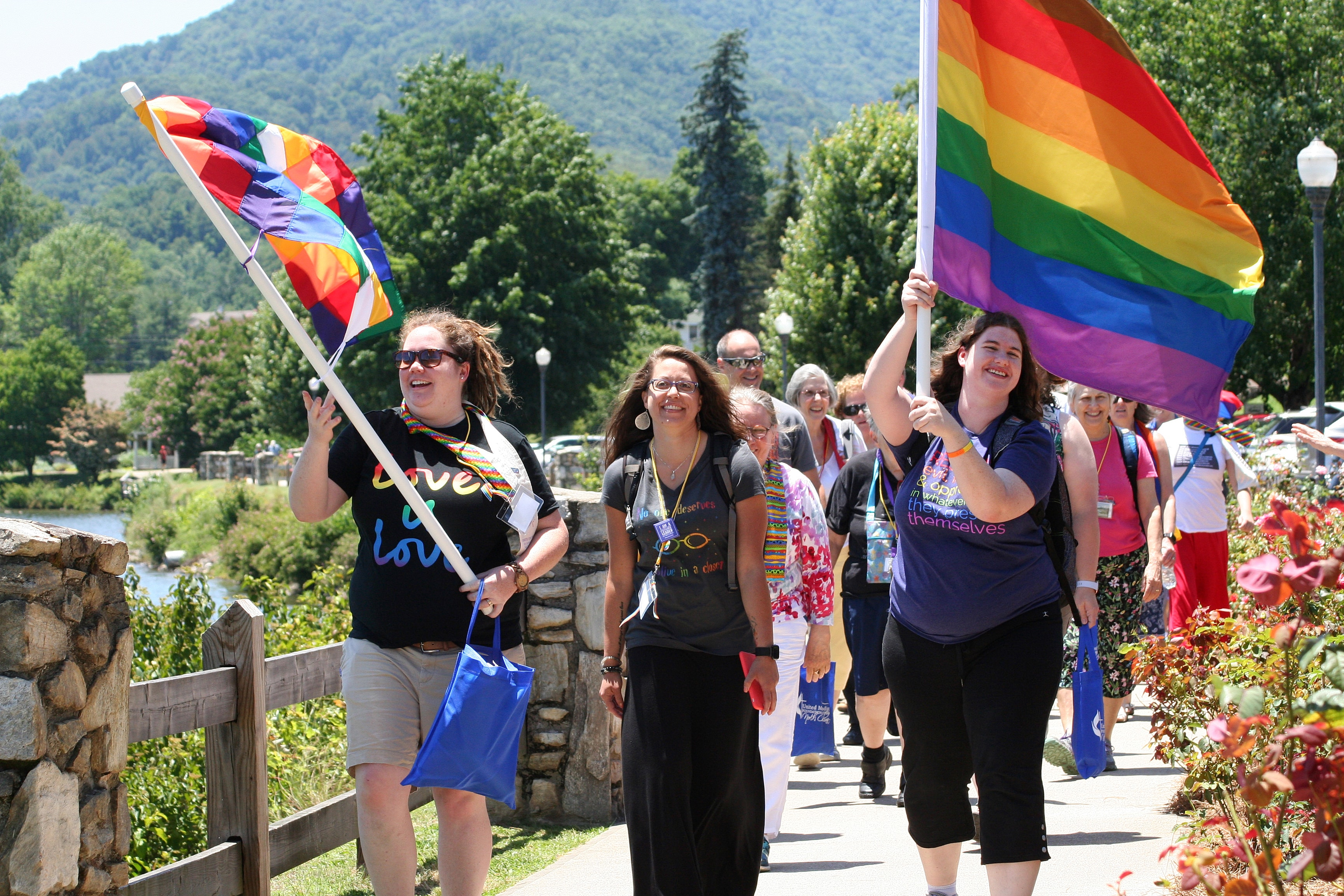 Participants walk in a Reconciling Ministries Pride March during the 2019 Western North Carolina Annual Conference held at Lake Junaluska. Photo by Neill Caldwell, Western North Carolina Conference.