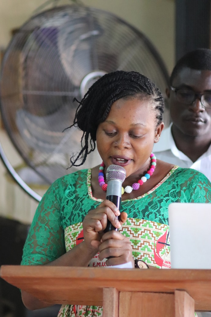 Lisette Che gives a report on the United Methodist Cameroon Mission Initiative. She serves as youth coordinator for the program. Photo by Isaac Broune, UM News.